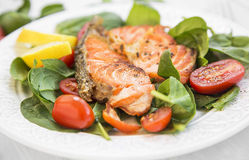 Grilled Salmon with Spinach and Tomatoes Salad,Selective Focus Stock Photo