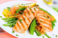 Grilled salmon with spring vegetables, soft focus Stock Photos