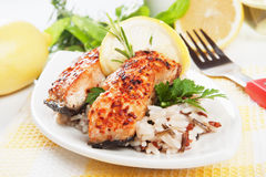 Grilled salmon steak. With lemon and rice Stock Images