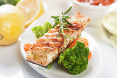 Grilled salmon steak. With rosemary and vegetables Royalty Free Stock Photos