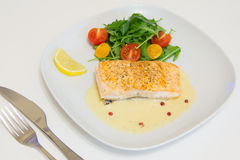Grilled salmon steak with beurre blanc sauce Royalty Free Stock Photo