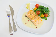 Grilled salmon steak with beurre blanc sauce Stock Image