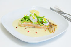 Grilled salmon steak with beurre blanc sauce Royalty Free Stock Photography