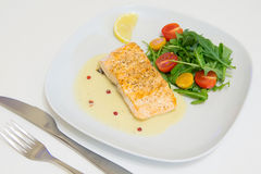 Grilled salmon steak with beurre blanc sauce Royalty Free Stock Photos