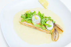 Grilled salmon steak with beurre blanc sauce Royalty Free Stock Images