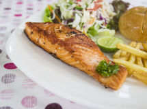 Grilled salmon steak. With bun, salad and french fried Stock Photos