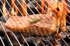 Grilled salmon steak on the flaming Royalty Free Stock Images