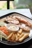 Grilled salmon steak with french fries and toast. Stock Photos