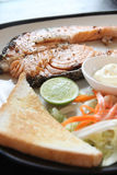 Grilled salmon steak with french fries and toast. Stock Images