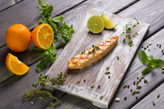 Grilled salmon steak with fresh herbs and citrus. Stock Image