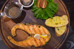 Grilled salmon steak with the fresh salad in white plate. Stock Photography