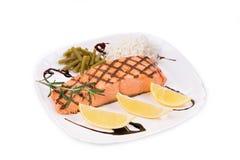 Grilled salmon steak with garnish. Stock Photo