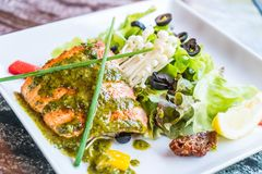 Grilled salmon steak. With salad Royalty Free Stock Photo