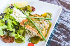 Grilled salmon steak. With salad Stock Image