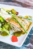 Grilled salmon steak. With salad Royalty Free Stock Photos