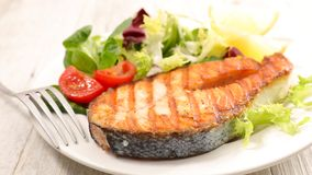 Grilled salmon steak. And salad Royalty Free Stock Images