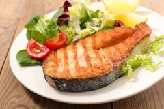 Grilled salmon steak. And salad Royalty Free Stock Image