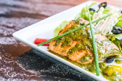 Grilled salmon steak. With salad Stock Images