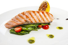 Grilled salmon steak with herbs and Stock Photo