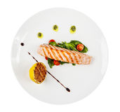 Grilled salmon steak with herbs Stock Image