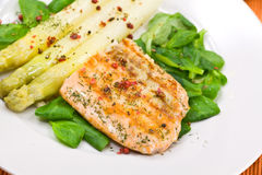 Grilled salmon steak with leaf lettuce Stock Images