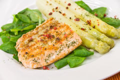 Grilled salmon steak with leaf lettuce Royalty Free Stock Photography