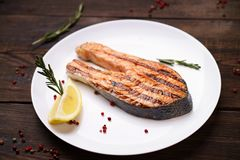 Grilled salmon steak with lemon slice. Tasty and delicious meals, dietary food, keto diet concept stock images
