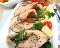Grilled salmon steak, lemon with vegetables, close up Royalty Free Stock Photo