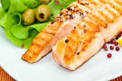 Grilled salmon steak with lettuce Stock Photo