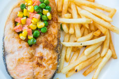 Grilled salmon steak meal served with salad Royalty Free Stock Image
