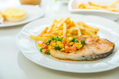 Grilled salmon steak meal served with salad Royalty Free Stock Images