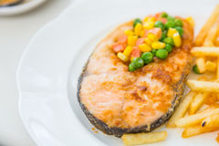 Grilled salmon steak meal served with salad Stock Images