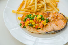 Grilled salmon steak meal served with salad Stock Photo
