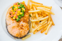 Grilled salmon steak meal served with salad Stock Photography