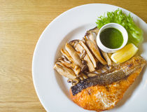 Grilled salmon steak and mushroom Stock Images