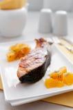 Grilled salmon steak with orange salsa Stock Photos