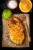 Grilled salmon steak with orange and thyme stock photo