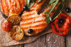Grilled salmon steak on paper. horizontal top view Royalty Free Stock Photography