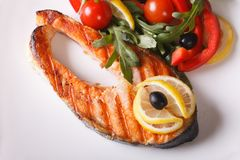 Grilled salmon steak on plate horizontal top view Stock Image
