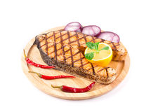 Grilled salmon steak on platter. On a white background Royalty Free Stock Images