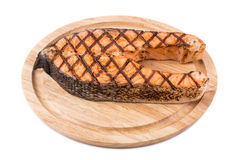 Grilled salmon steak on platter. Royalty Free Stock Images