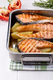 Grilled salmon steak with potatoes royalty free stock photo