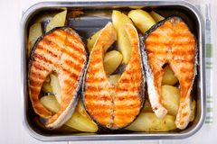 Grilled salmon steak with potatoes royalty free stock image