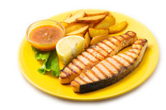 Grilled salmon steak with potatoes and sauce Stock Photography