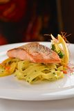 Grilled salmon steak on ribbon pasta Stock Images