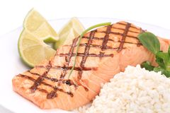 Grilled salmon steak with rice and lime. Stock Photography