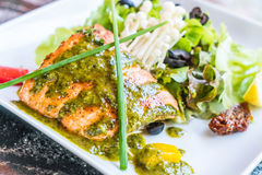 Grilled salmon steak. With salad Stock Photography