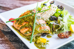 Grilled salmon steak. With salad Royalty Free Stock Photography