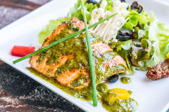 Grilled salmon steak. With salad Royalty Free Stock Images
