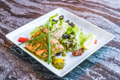 Grilled salmon steak. With salad Stock Photo